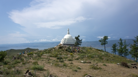 Stupa of Enlightenment on the island Ogoy in the middle of the Lake Baykal  photo