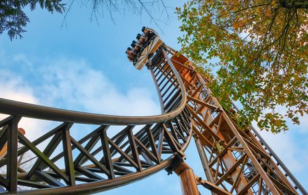 Abandoned theme park roller coaster ride in autumn in europe