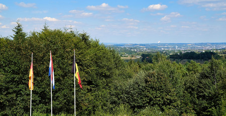 Flags from Netherlands, Belgium and Germany on three country border in Vaals, the Netherlands