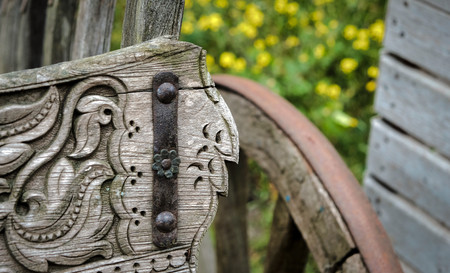 Detail of old wooden cart in a park in amsterdam