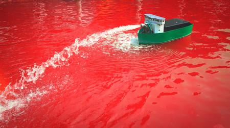 Miniatuurmodel van een boot in een haven in Madurodam, Nederland Stockfoto