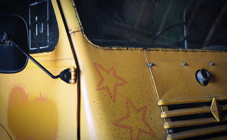 The front of an abandoned old yellow truck in the netherlands 写真素材