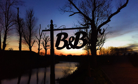 bed and breakfast sign silhouette in the sunset in the netherlands amsterdam