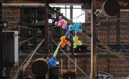 Still life of vintage baby mobile with colorful moving animals. against industrial background in amsterdam the netherlands