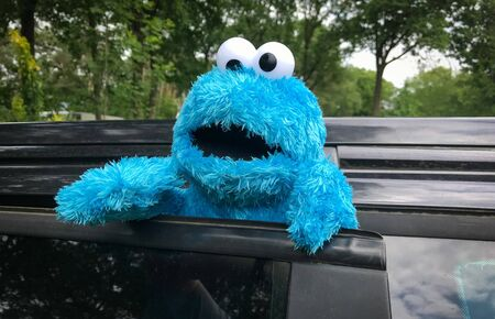 Cookie Monster, a Muppet on the long-running children's television show Sesame Street, is smoking a cigarette in a car in amsterdam, the netherlands