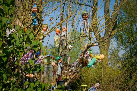 Hanged puppets fly on the wind and attracts tourists to the souvenir market in amsterdam netherlands