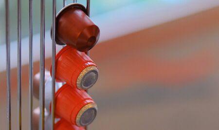 Coffee cups in Holder orange in front of windows in amsterdam Stok Fotoğraf - 133359652