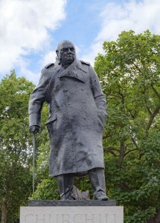 statue of winston churchill in london in front of trees united kingdom