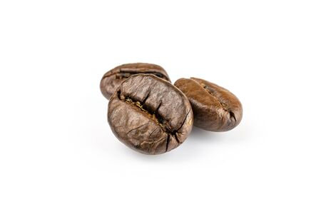 Three shiny fresh roasted coffee beans isolated on white background. Coffee background or texture concept. 스톡 콘텐츠