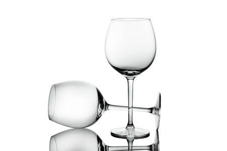 Empty elegant Crystal wine glasses with wine isolated on white background. Alcohol beverage card backdrop.