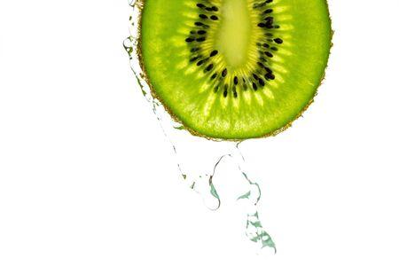 Kiwi water. Green kiwifruit isolated on white background. Organi
