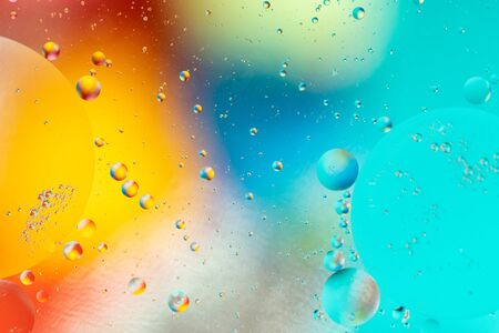 Abstract background, colorful gradient colors. Oil drops in water. Imagens