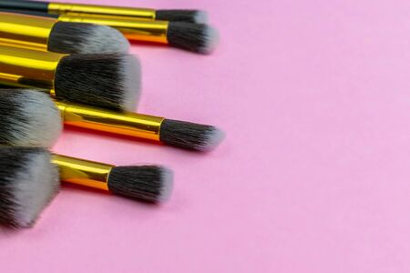Makeup brush drawing. Cosmetic powder products isolated on pink