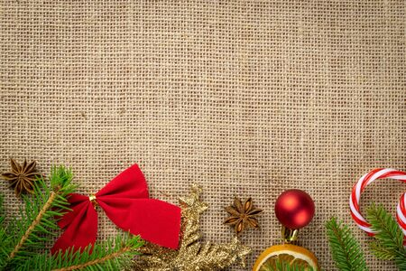 New year, Xmas decoration isolated on linen texture background.Red Christmas decorations.Holiday festive celebration concept.Banner mock up for display of product or design content
