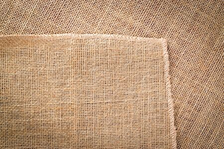 Canvas texture. Linen Natural organic brown Backdrop. Woven Material Beige background