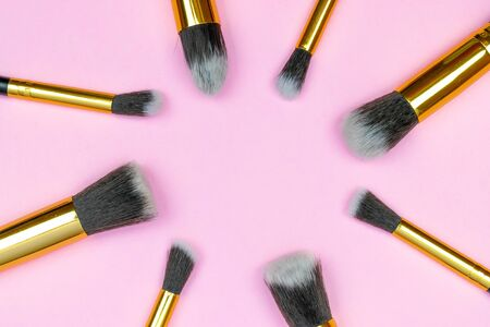 Make brush powder. Drawing cosmetic products isolated on pink background with copy space. Beauty glamour concept