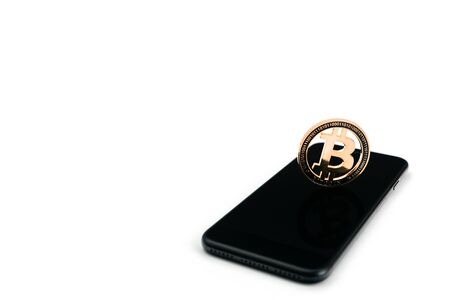 Bitcoin exchange. Gold coin with black smartphone on white. Litecoin, Ethereum Cryptocurrency background.