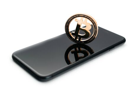Bitcoin Cash. Gold Cryptocurrency with black smartphone. Falling coins isolated on white. Litecoin, Ethereum Cryptocurrency background. Bitcoin concept