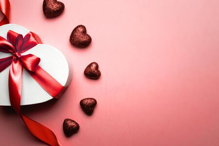 Valentine day composition: white gift box with bow and red ribbon heart, photo template, background. Top View. View from above, copy space, romance seasonal holiday Stock Photo - 137443250