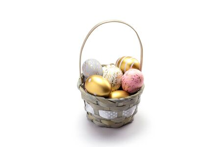 Easter egg background with golden shine decorated eggs in basket isolated on white. Happy Easter.