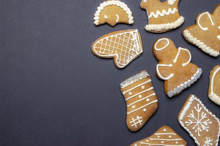 Gingerbread man. Xmas homemade Ginger, Honey cookies on dark background. Merry Christmas greeting card, banner. Winter holiday xmas theme. Happy New Year. Space for text Stock Photo
