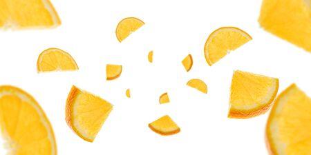 Orange slice isolated. Citrus fruit tangerine falling in air. Selective focus Imagens