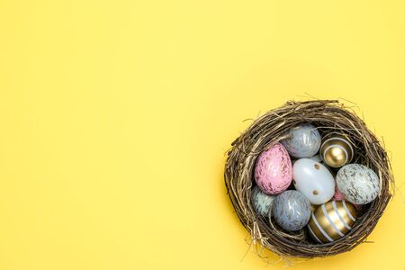 Happy Easter background. Colorful shine decorated eggs isolated on yellow. For greeting card, promotion, poster, flyer, web-banner, article