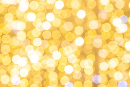 Gold bokeh lights. Abstract glitter festive blur background. Christmas and New Year holidays backdrop