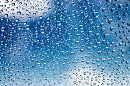 Drops of water. Wet rain on glass pattern texture background.