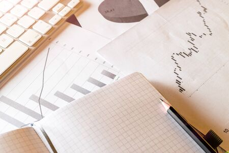 Charts background. Diagrams graphs and financial documents on table. Finance analysis background. Planner and Agenda Concept