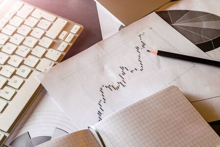 Statistical analysis process control. Finance diagrams and graphs in office table. Financial analytics workspace. Planner and Agenda Concept
