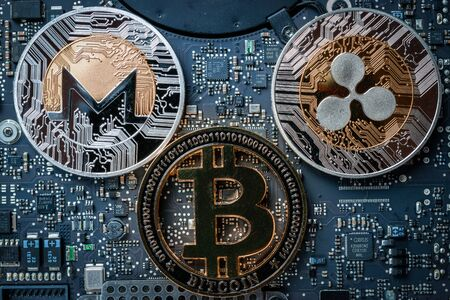 Bit coin Gold Cryptocurrency on Computer electronic circuit board motherboard. Litecoin, Ethereum CryptoCash Technology Background concept.
