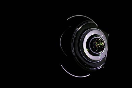 Lense light. Flare reflection on photo, video camera on black background. Gleams rounded and hexagonal shapes, rainbow halo Stock Photo