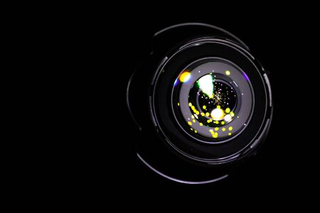 Lenses reflection Flare lights on shutter of photo, video camera isolated on black background. Optical ray flash effect in photographer equipment.