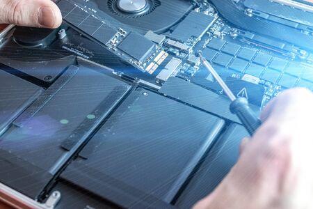 Technology repair of pc electronic equipment. Computer service. Technician engineer man do maintenance of hardware Stock Photo