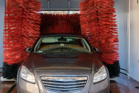 Wash car. Carwash service with water, soap. Hand clean vehicle auto from foam. Automatic care, waxing.