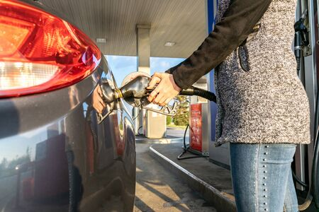 Refueling car. Pump gas at petrol fuel station. Gasoline oil nozzle tank from hand person. Automotive industry or transportation concept