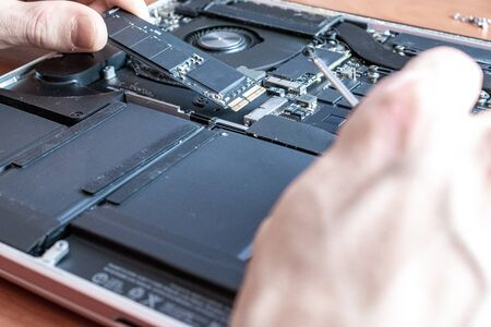 Motherboard service. Technology hardware repair and electronic computer maintenance from technician engineer man. Support pc equipment Stock Photo