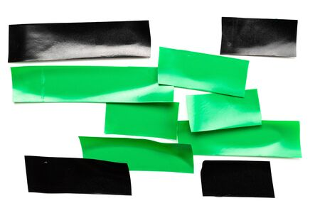 Tape roll. Black adhesive paper and green sticky piece scotch isolated on white background. Torn strip grunge texture