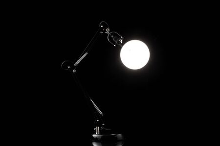 Office modern table lamp isolated on black. Light furniture for night room design or business decor.