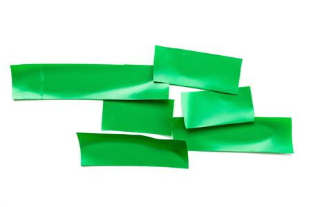 Adhesive sticky paper. Piece of green duct scotch tape isolated on white background. Torn strip grunge texture.
