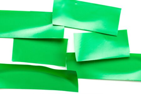 Piece scotch. Adhesive paper tape or green sticky duct strip isolated on white background. Torn grunge texture.