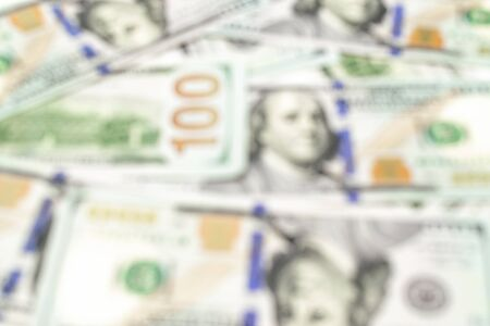 Money abstract blurred background. 100 Hundred dollars of usa America in soft focus. Usd bill, paper cash.