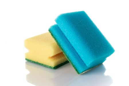 Cleaning sponge isolated on kitchen white background. Household clean equipment background. Supplies for cleaner service.