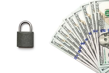 Money saved. American money. Washington American cash with padlock isolated on white, usd background. Top view with copy space.