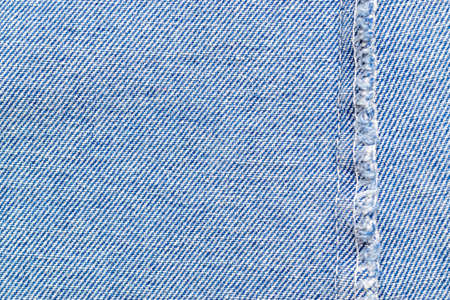 Blue background pattern in close up view. Jean denim texture for fashion cloth with copy space. Fabric material textile Imagens