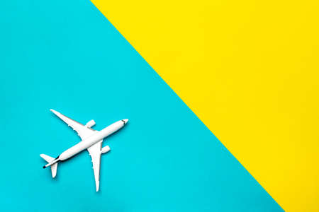 Toys kids aircraft backdrop. White toy airplane in close up view with copy space for flight air plane travel concept.