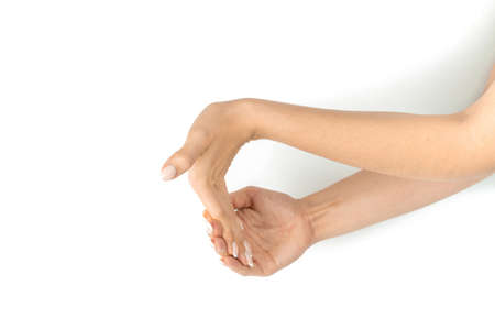 Stretching arms. Healthy workout exercise. Woman hand massage for carpal tunnel syndrome protection. Female finger exercise, stretch therapy for pain wrist protective isolated on white background. Stock Photo