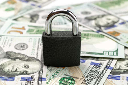 Money saved. American money. Washington American cash with padlock isolated on white, usd background