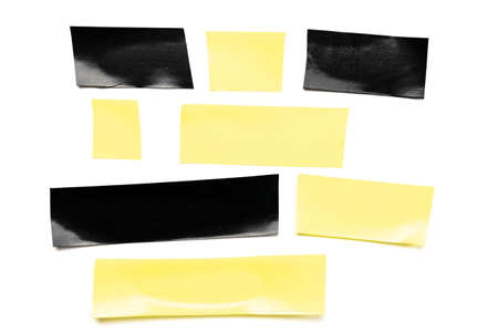 Tape roll. Adhesive paper or yellow and black sticky piece scotch isolated on white background. Torn strip grunge texture